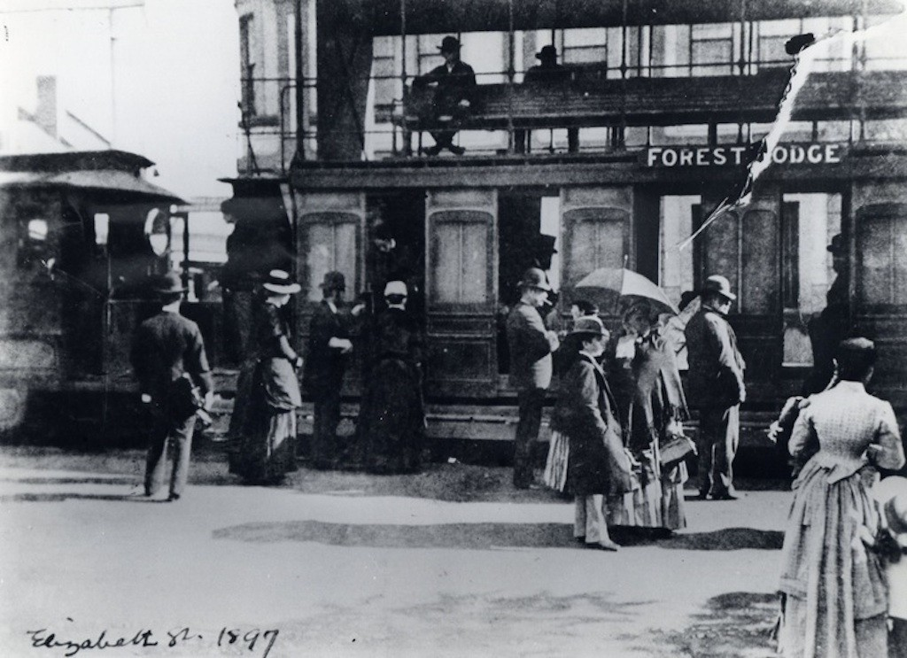 5 People standing next to Forest Lodge tram 1897 RAHS