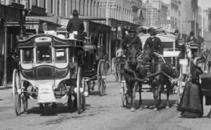 The picture is from the Kerry collection showing two buses in George Street around 1890.