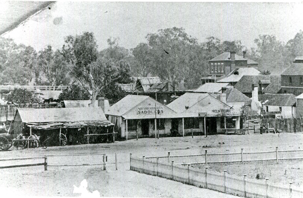 Lachlan Street c.1881 view of Blacksmith, Saddlery and Oyster Bar – Note bridge and Australian Hotel in background