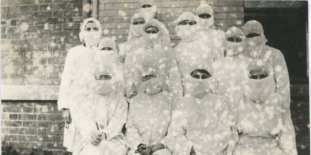 Group of nurses wearing masks, Photographer unknown, 1919 [Image courtesy of the Macleay Museum, University of Sydney, HP85.8.87]