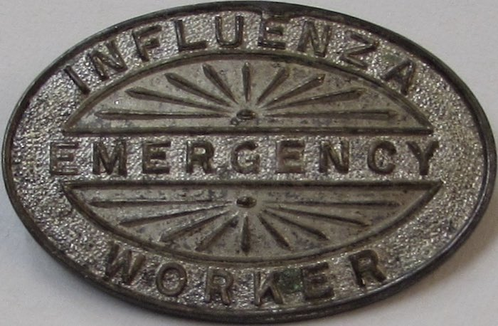 Influenza emergency worker, metal badge, made by Angus & Coote Ltd, Sydney, 1919. Donated by Miss Annie Hodge 1946 [RAHS Manuscript Collection]