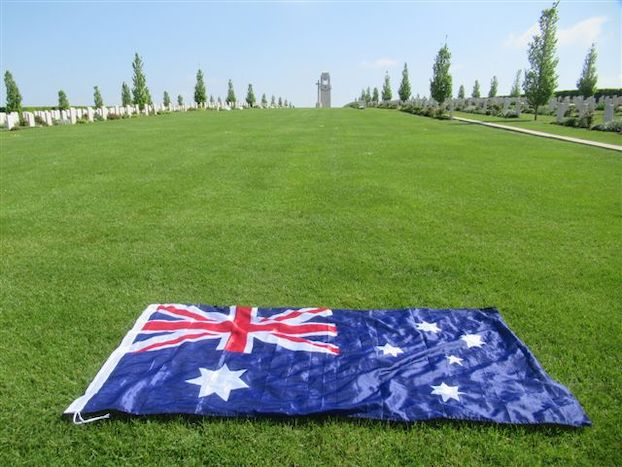 An Australian flag laid on the grass surrounding the memorial at Villers-Bretonneux. Photograph by Marie-Paule Bonte, 2020.