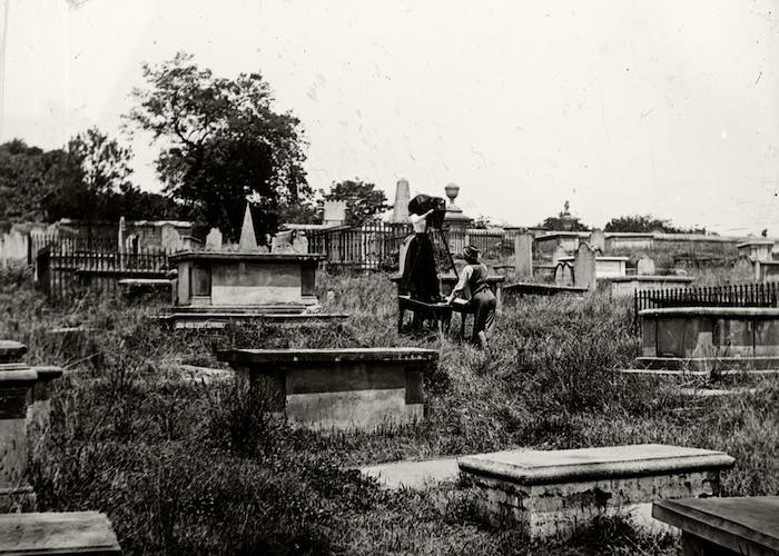 A.G. & J.E. Foster photographing headstones in cemetery