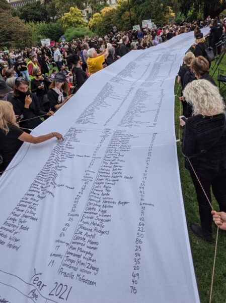Banner at Melbourne March 4 Justice listing all Australian women killed by gendered violence since 2008.