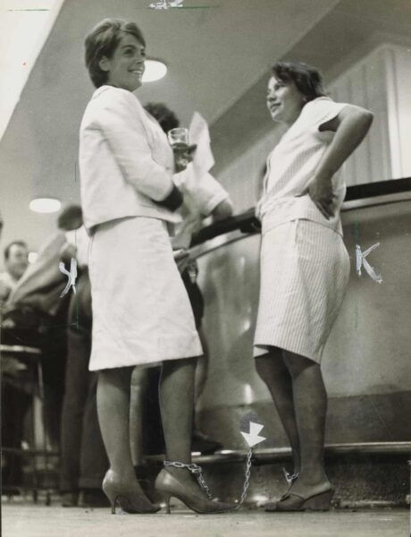 Rosalie Bogner and Merle Thornton chained to the bar at the Brisbane Regatta Hotel.