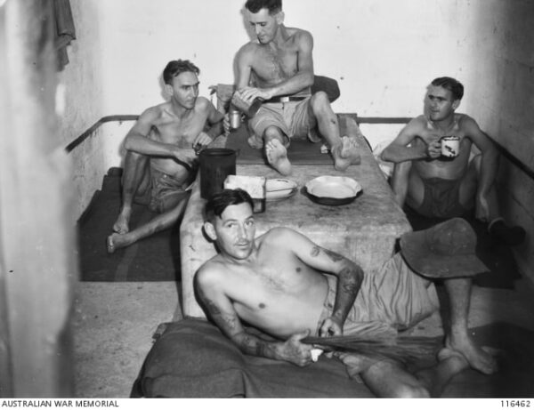 Ex-POWs show the conditions of their cell at Changi